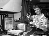 Debbie Reynolds on a Strip Making Waffles