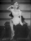 Mamie Van Doren sitting in White Fur Dress