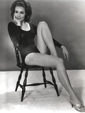 Julie Newmar Siting on Chair in Black Dress