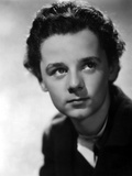 Freddie Bartholomew smiling in Leather Dress