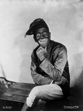 Al Jolson sitting while Giving A Big Smile
