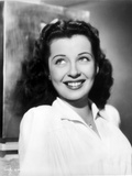 Gail Russell smiling in White Collared Shirt