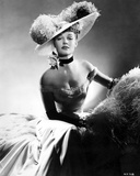 Ann Sheridan wearing a Gown with a Big Hat
