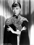 Anna Wong wearing a Glittering Black Garment