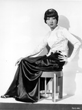 Anna Wong sitting on the Chair  Hand on Hips