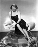 Ann Sheridan sitting Elegantly on the Chair