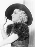 Mae West Posed in Black furry Dress with Hat