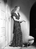 Joan Bennett wearing a Long Glittering Dress