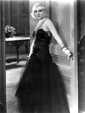 Pola Negri on a Lace Dress Holding a Door Knob