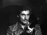 Timothy Dalton in Leather Jacket With Pistol