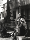Dolores Del Rio sitting Outside the House
