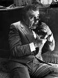 Herbert Lom Talking in Suit With Telephone