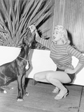 Jayne Mansfield sitting in Sweater with Dog