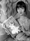 Louise Brooks Posed in Floral Dress with Book