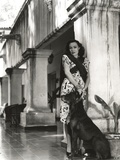 Dolores Del Rio Posed in Classic with a Dog