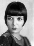 Louise Brooks smiling in White Dress Portrait