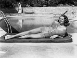 Rita Hayworth Lying on the Side of the Pool