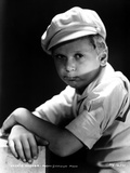 Jackie Cooper Leaning on Table With Cap