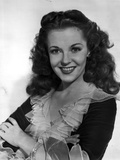 Vivian Blaine on a Ruffled Top and smiling