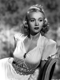Carole Landis in a Dress with Metal Belt