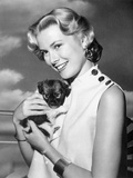 Grace Kelly Carring Cute Puppy Portrait