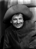 Wallace Beery smiling in Cowboy Outfit