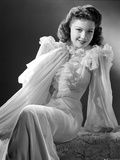Anne Baxter on a Ruffled Dress sitting