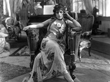 Theda Bara on Printed Dress and sitting