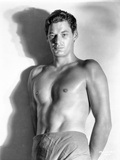 Johnny Weissmuller standing in a Portrait