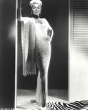Lana Turner Leaning in Long White Gown