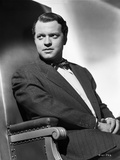 Orson Welles Seated in Coat and Bowtie
