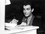 Robert Taylor Writing on Paper in Suit