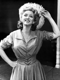 Celeste Holm on a Dress Holding her Hat
