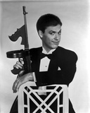 Michael Keaton in Black Suit With Rifle