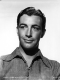 Robert Taylor Posed in Checkered Shirt