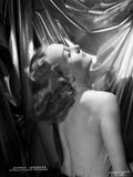 Carole Lombard wearing a Backless Dress