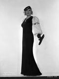 Mae West Posed in Black with Fur Sleeves