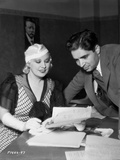 Mae West smiling in Casual Dress with Man