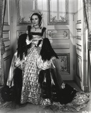 Dolores Del Rio Posed in Shiny Long Dress