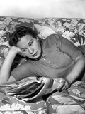Shirley Booth Lying on a Bed and Reading