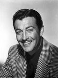 Robert Taylor smiling in Checkered Suit