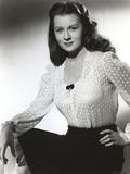 Rhonda Fleming smiling in White Blouse