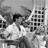 George Hamilton sitting on Chair With Doll