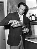 Robert Vaughn in Black Suit With Glass