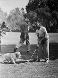 Katharine Hepburn Playing Golf with Dog
