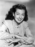 Gail Russell smiling in Checkered Shirt