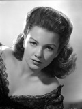 Anne Baxter on a Dress Leaning and posed