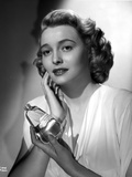 Patricia Neal Holding Perfume in Dress