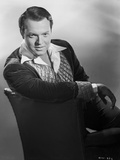 Orson Welles sitting in Black and White