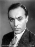 Charles Boyer Posed in Suit and Tie